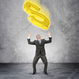 Businessman catching dollar sign Stock Images
