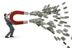 The businessman catching dollars on horseshoe magnet. Businessman catching dollars on horseshoe magnet Stock Photo