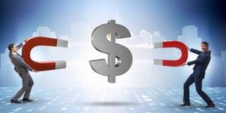 The businessman catching dollars on horseshoe magnet Stock Image