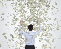 Businessman catching falling dollar Royalty Free Stock Images