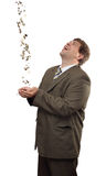 Businessman catching falling money. Happy businessman catching falling money coins Stock Photo