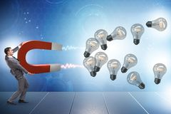 The businessman catching light bulbs on horseshoe magnet. Businessman catching light bulbs on horseshoe magnet Stock Images