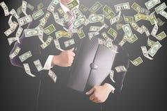 Businessman catching money Royalty Free Stock Photos
