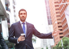 Businessman catching taxi Stock Image
