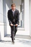 businessman caucasian riding scooter Στοκ Εικόνες