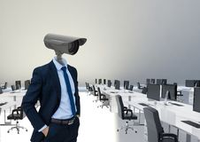 Businessman with CCTV head at office. Digital composite of Businessman with CCTV head at office Royalty Free Stock Photo