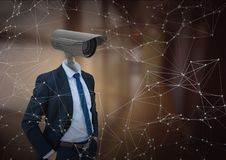 Businessman with CCTV head at office. Digital composite of Businessman with CCTV head at office Stock Photography