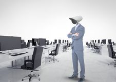 Businessman with CCTV head at office. Digital composite of Businessman with CCTV head at office Royalty Free Stock Photography