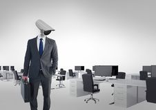 Businessman with CCTV head at office. Digital composite of Businessman with CCTV head at office Royalty Free Stock Image