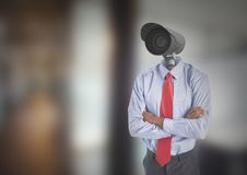 Businessman with CCTV head at office. Digital composite of Businessman with CCTV head at office Royalty Free Stock Images