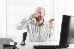 Office Worker Celebrate with Cognac and Cigar Royalty Free Stock Photo