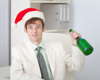 Businessman celebrates Christmas at office Stock Photography