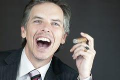 Businessman Celebrates With Cigar Royalty Free Stock Image
