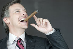 Businessman Celebrates With Cigar, Side View Stock Photos