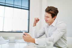 Businessman celebrates with fist up Stock Photo