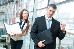 Businessman celebrates good news from coworker Stock Image