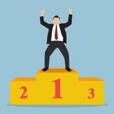 Businessman celebrates on Winning Podium Stock Image