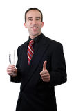 Businessman Celebrating. A young businessman celebrating with a glass of sparkling wine Royalty Free Stock Images