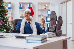 The businessman celebrating christmas holiday in the office Royalty Free Stock Image