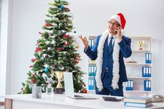 The businessman celebrating christmas holiday in the office Stock Photo