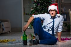 The businessman celebrating christmas at home alone Royalty Free Stock Photos