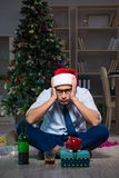The businessman celebrating christmas at home alone Royalty Free Stock Photography