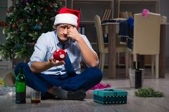 The businessman celebrating christmas at home alone. Businessman celebrating christmas at home alone Royalty Free Stock Photos