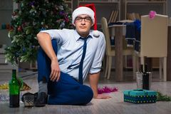 The businessman celebrating christmas at home alone. Businessman celebrating christmas at home alone Royalty Free Stock Photography