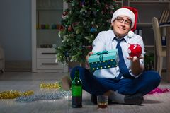 The businessman celebrating christmas at home alone Stock Images