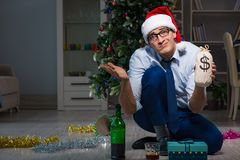 The businessman celebrating christmas at home alone. Businessman celebrating christmas at home alone Stock Photography