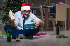 The businessman celebrating christmas at home alone Stock Photography