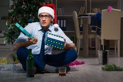The businessman celebrating christmas at home alone. Businessman celebrating christmas at home alone Stock Photo