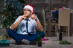 The businessman celebrating christmas at home alone. Businessman celebrating christmas at home alone Royalty Free Stock Image