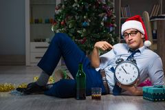 The businessman celebrating christmas at home alone. Businessman celebrating christmas at home alone Stock Images
