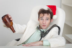 Businessman celebrating Christmas at office Stock Photo