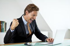 A businessman celebrating a deal royalty free stock photography