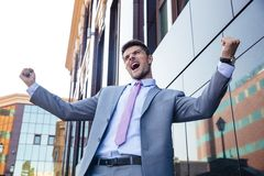 Businessman celebrating his success outdoors Stock Photos