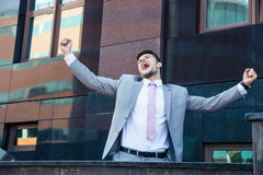 Businessman celebrating his success outdoors Stock Photography