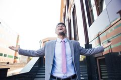 Businessman celebrating his success outdoors Royalty Free Stock Photography