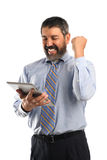 Businessman Celebrating While Looking at Electronic Tablet Stock Images