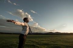 Businessman celebrating a new day Stock Image