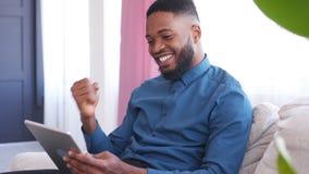 Businessman celebrating online success stock video footage