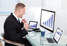 Businessman celebrating a performance graph Royalty Free Stock Image