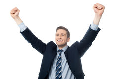 Businessman celebrating success with arms up Royalty Free Stock Photo