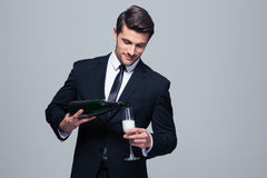 Businessman celebrating success, pouring champagne Royalty Free Stock Photo