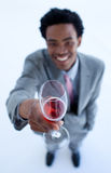 Businessman celebrating a success with wine Royalty Free Stock Image
