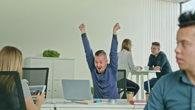 Businessman Celebrating Victory Looking at Laptop Stock Images