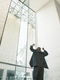 Businessman Celebrating Victory In Office Building Stock Images