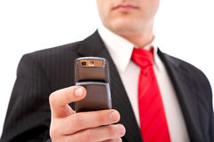 Businessman with cell phone Royalty Free Stock Photography