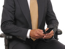 Businessman with cell phone Stock Image